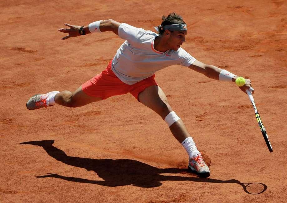 TOPSHOTS Spain's Rafael Nadal returns to Serbia's Novak Djokovic during their French tennis Open semi-final match at the Roland Garros stadium in Paris on June 7, 2013. AFP PHOTO / KENZO TRIBOUILLARDKENZO TRIBOUILLARD/AFP/Getty Images Photo: KENZO TRIBOUILLARD, AFP/Getty Images / AFP