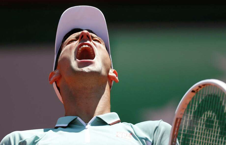 TOPSHOTS Serbia's Novak Djokovic reacts after a point against Spain's Rafael Nadal during their French tennis Open semi final match at the Roland Garros stadium in Paris on June 7, 2013. AFP PHOTO / THOMAS COEXTHOMAS COEX/AFP/Getty Images Photo: THOMAS COEX, AFP/Getty Images / AFP