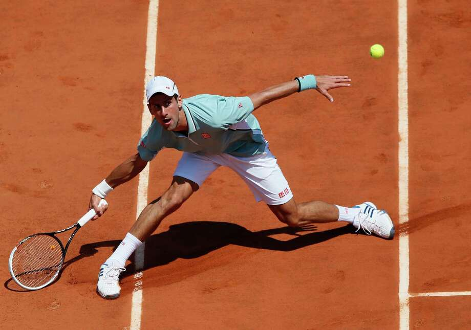 TOPSHOTS Serbia's Novak Djokovic returns a shot to Spain's Rafael Nadal during their French tennis Open semi final match at the Roland Garros stadium in Paris on June 7, 2013. AFP PHOTO / PATRICK KOVARIKPATRICK KOVARIK/AFP/Getty Images Photo: PATRICK KOVARIK, AFP/Getty Images / AFP