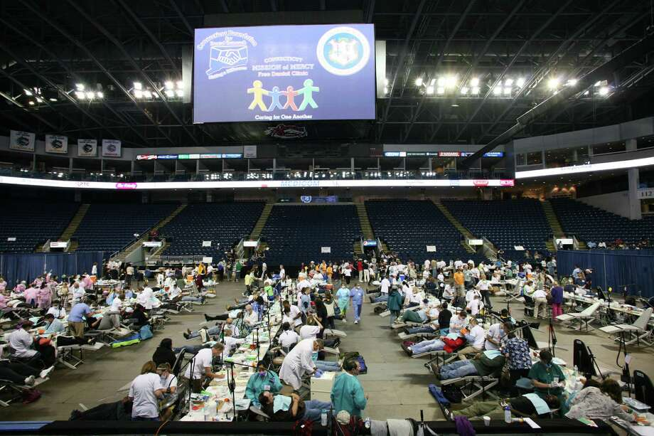The 6th Annual Connecticut Mission of Mercy (CTMOM) free dental clinic took place at Bridgeport's Webster Bank Arena Friday, June 7, 2013. Photo: David Ames / Greenwich Time Freelance
