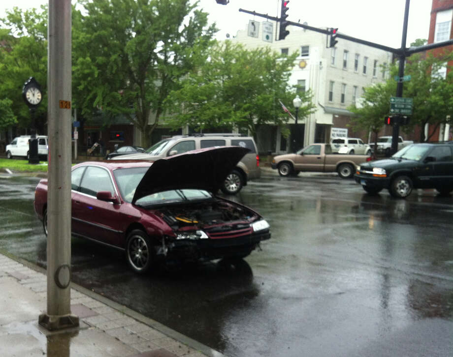 One of the cars involved in a collision on Friday morning, June 7, 2013, near the intersection of Main Street and White Street, police said. Photo: Libor Jany