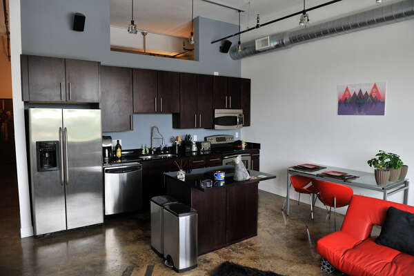 The kitchen and dining area of  Judson Candy Factory Lofts resident Jimmy Wells is simple and sleek.