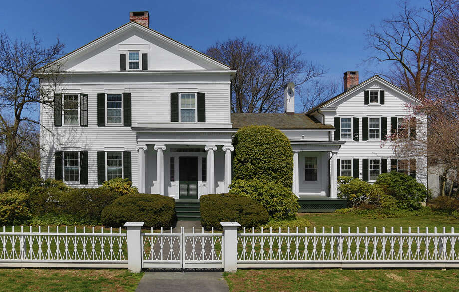 This Greek Revival-style house at 104 Old South Road, built circa 1830 for a Southport sea captain, is on the market for $3.2 million. Photo: Contributed Photo / Fairfield Citizen contributed