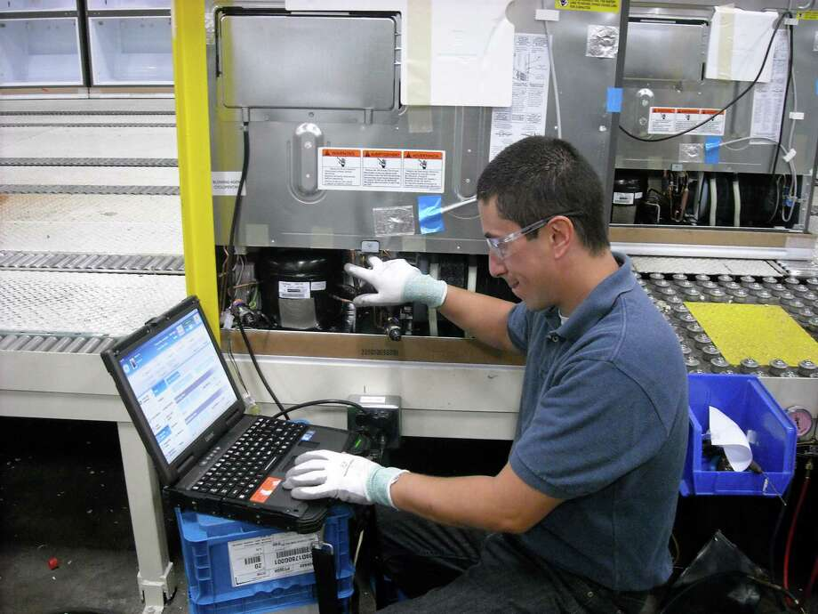 Service technician Louis Santos demonstrates GE's NewFi system for new French-door refrigerators. GE hopes to improve the accuracy of service calls. Photo: Courtesy Of GE Appliances