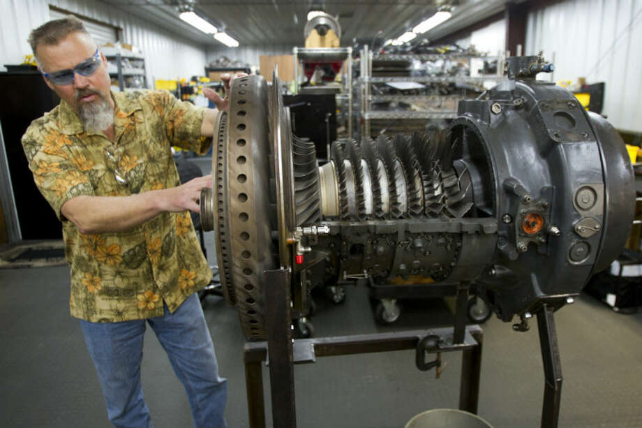 Ted McIntyre, CEO of Turbine Power Technology, talks about a turbine engine from a Chinook helicopter that is being refurbished for use in a hydraulic fracturing unit. ( Brett Coomer / Houston Chronicle )