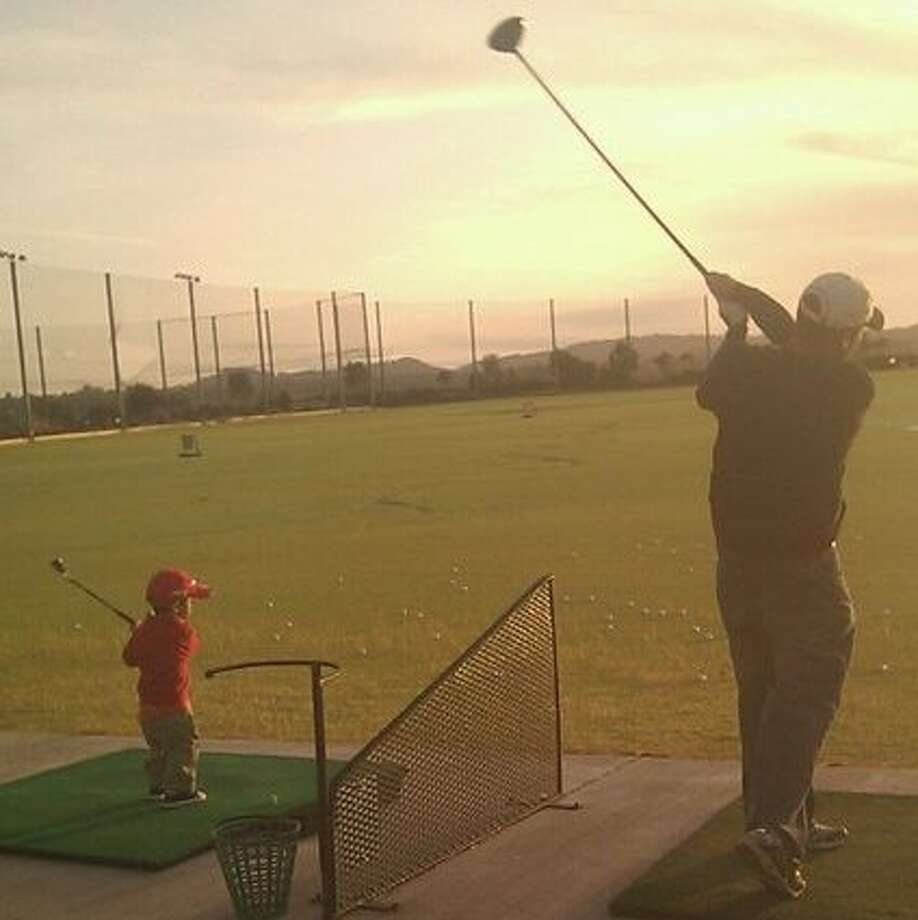This father and son prefer golf. Photo: Hafalia