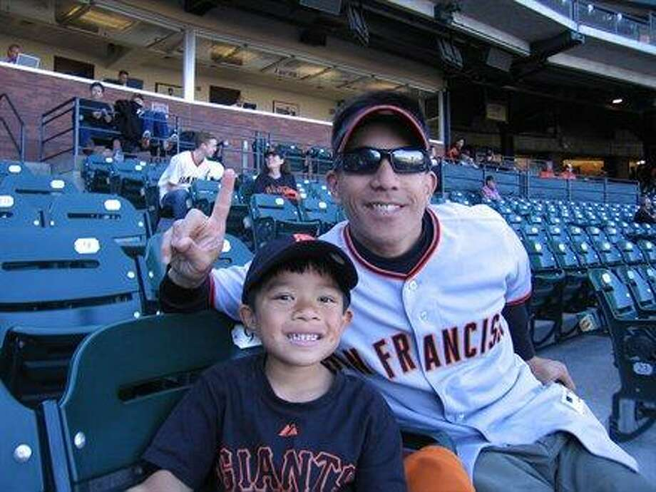 Some dads and sons are Giants fans. Photo: Huey49