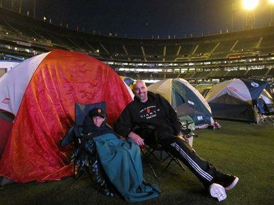 This father and son are hardcore fans. They camped out at AT&T park.