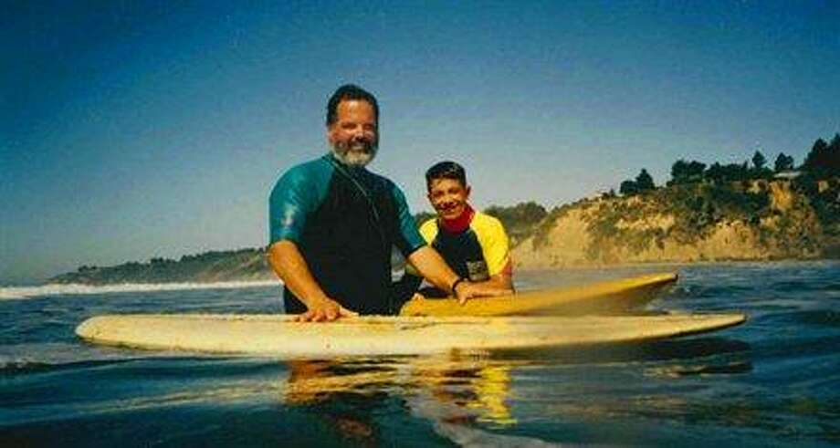 Some dads take their sons surfing. Photo: Mdadaos