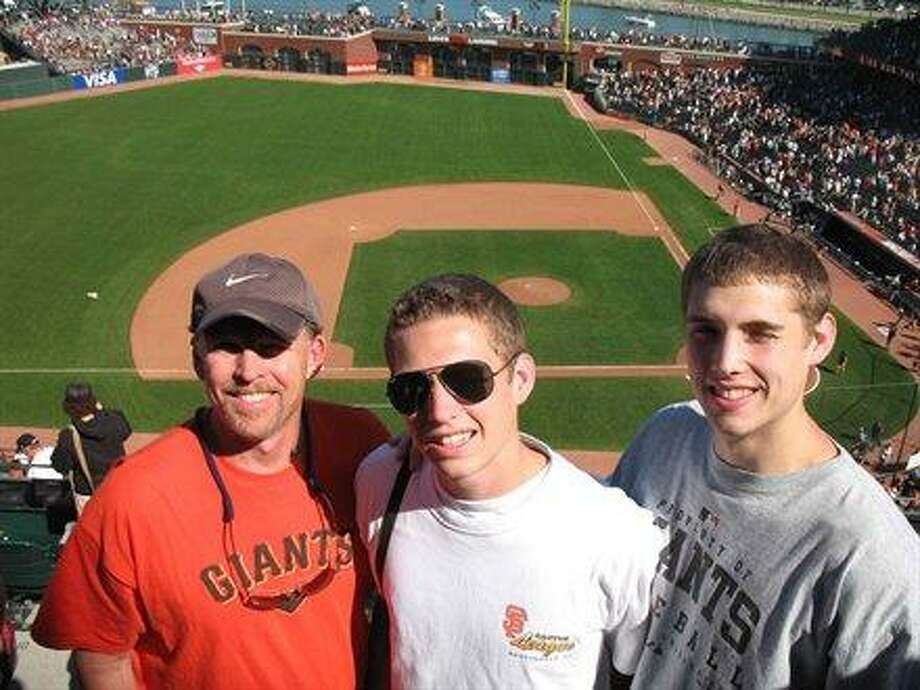 These boys took their dad to the baseball game.