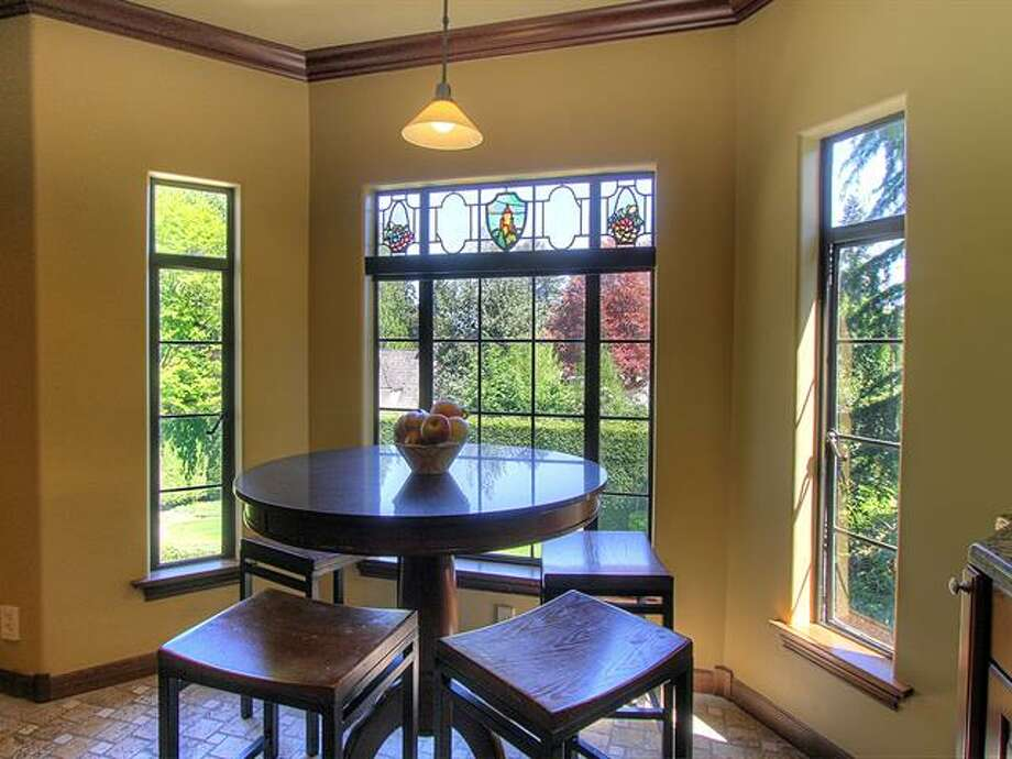 Breakfast nook of 1952 Shenandoah Drive East. The 5,380-squarep-foot house, built in 1928, has five bedrooms, 3.5 bathrooms, a family room with a fireplace, French doors, tile and wood floors, a wine cellar, a terrace and a patio with a fountain on a quarter-acre lot. It's listed for $2.595 million. Photo: Courtesy Adrienne Loop, Windermere Real Estate