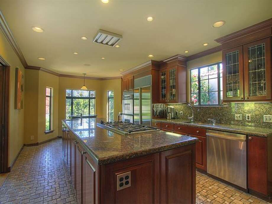Kitchen of 1952 Shenandoah Drive East. The 5,380-squarep-foot house, built in 1928, has five bedrooms, 3.5 bathrooms, a family room with a fireplace, French doors, tile and wood floors, a wine cellar, a terrace and a patio with a fountain on a quarter-acre lot. It's listed for $2.595 million. Photo: Courtesy Adrienne Loop, Windermere Real Estate