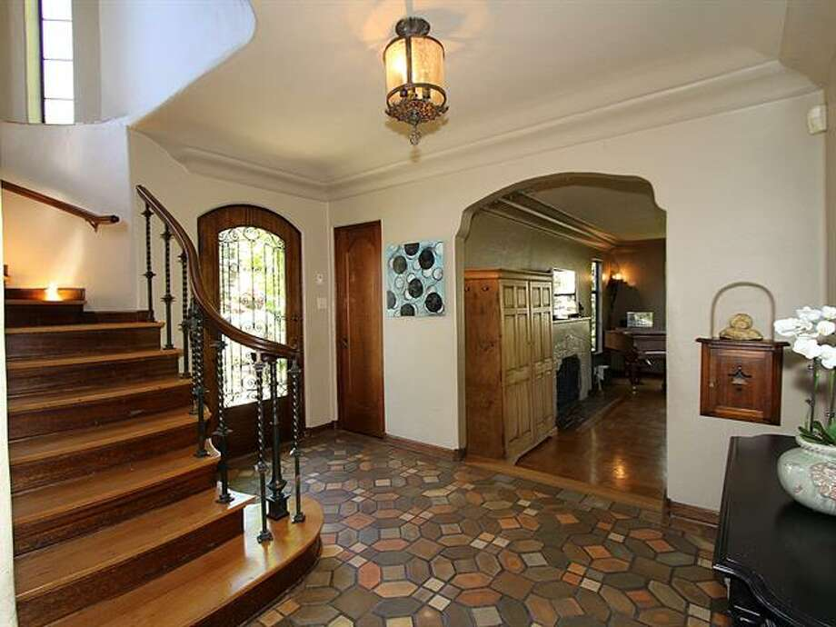 Entry of 1952 Shenandoah Drive East. The 5,380-squarep-foot house, built in 1928, has five bedrooms, 3.5 bathrooms, a family room with a fireplace, French doors, tile and wood floors, a wine cellar, a terrace and a patio with a fountain on a quarter-acre lot. It's listed for $2.595 million. Photo: Courtesy Adrienne Loop, Windermere Real Estate