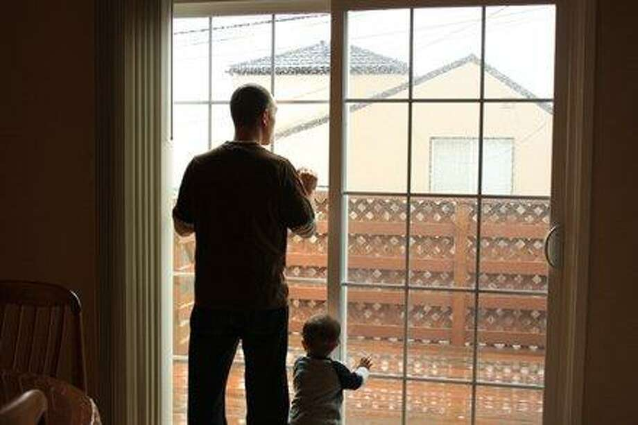 Some dads and sons watch the rain together. Photo: Amyjeff