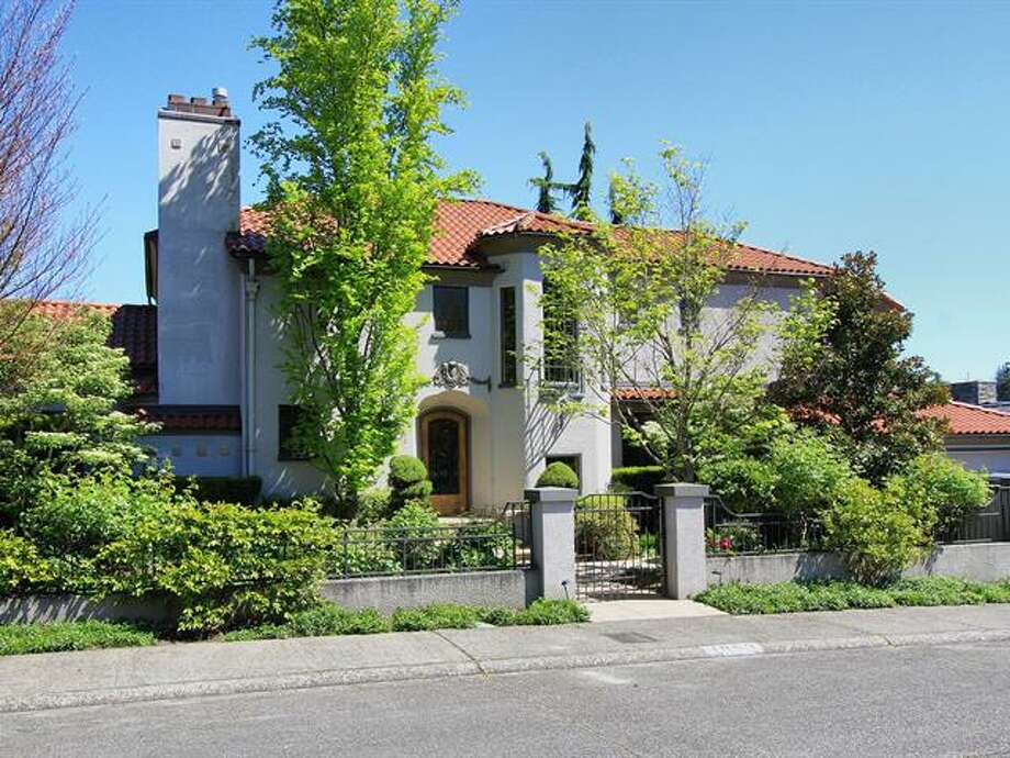 Want space and exclusivity in Seattle? Check out this Mediterranean-style home in Broadmoor, 1952 Shenandoah Drive East. The 5,380-squarep-foot house, built in 1928, has five bedrooms, 3.5 bathrooms, a family room with a fireplace, French doors, tile and wood floors, a wine cellar, a terrace and a patio with a fountain on a quarter-acre lot. It's listed for $2.595 million. Photo: Courtesy Adrienne Loop, Windermere Real Estate