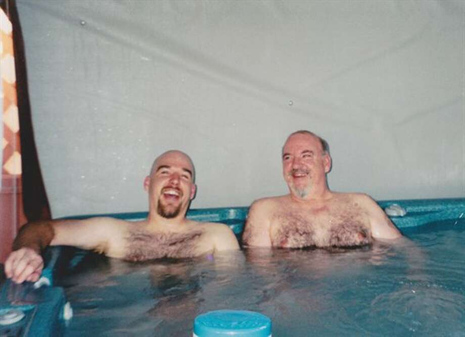 Some dads and sons sit in hot tubs together. Photo: Ballardthedome