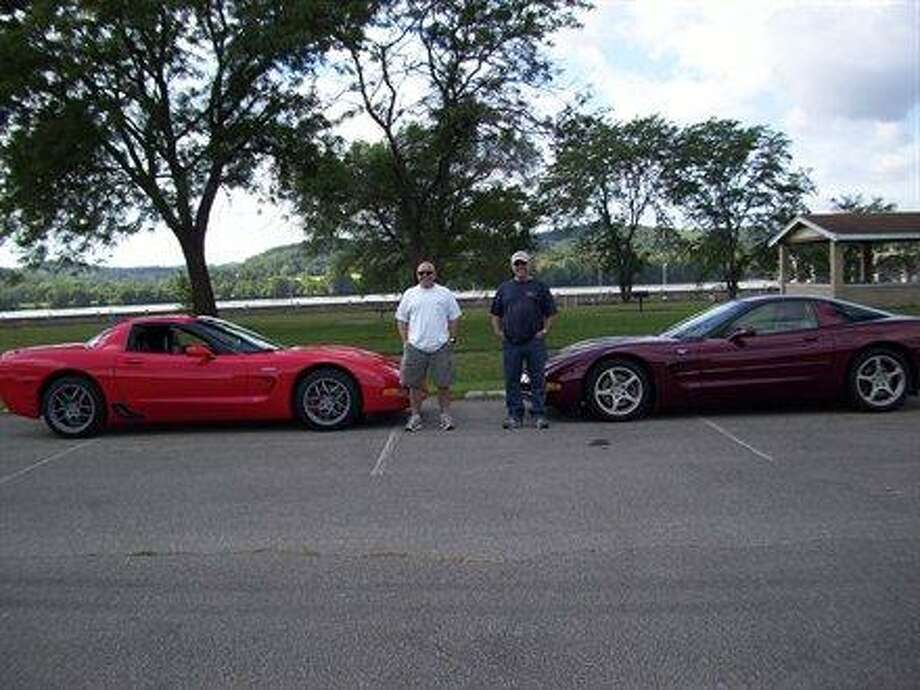 Some fathers and sons show off their cars. Photo: Sussews