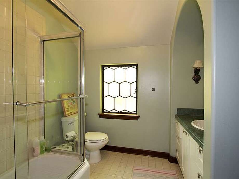 Bathroom of 1952 Shenandoah Drive East. The 5,380-squarep-foot house, built in 1928, has five bedrooms, 3.5 bathrooms, a family room with a fireplace, French doors, tile and wood floors, a wine cellar, a terrace and a patio with a fountain on a quarter-acre lot. It's listed for $2.595 million. Photo: Courtesy Adrienne Loop, Windermere Real Estate