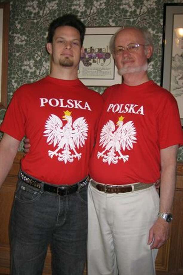 This father and son have the same red Polska T-shirts.