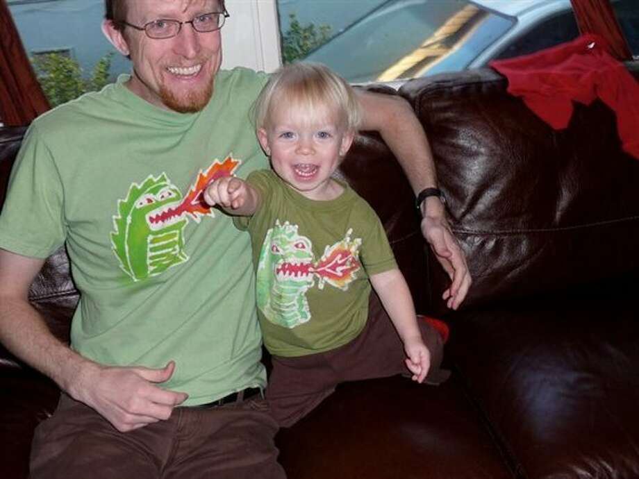 This father and son both have dragons on their shirts. Photo: Ecstaticskeptic
