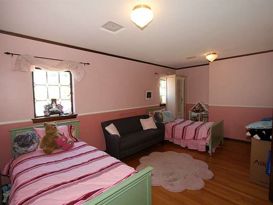 Bedroom of 1952 Shenandoah Drive East. The 5,380-squarep-foot house, built in 1928, has five bedrooms, 3.5 bathrooms, a family room with a fireplace, French doors, tile and wood floors, a wine cellar, a terrace and a patio with a fountain on a quarter-acre lot. It's listed for $2.595 million. Photo: Courtesy Adrienne Loop, Windermere Real Estate