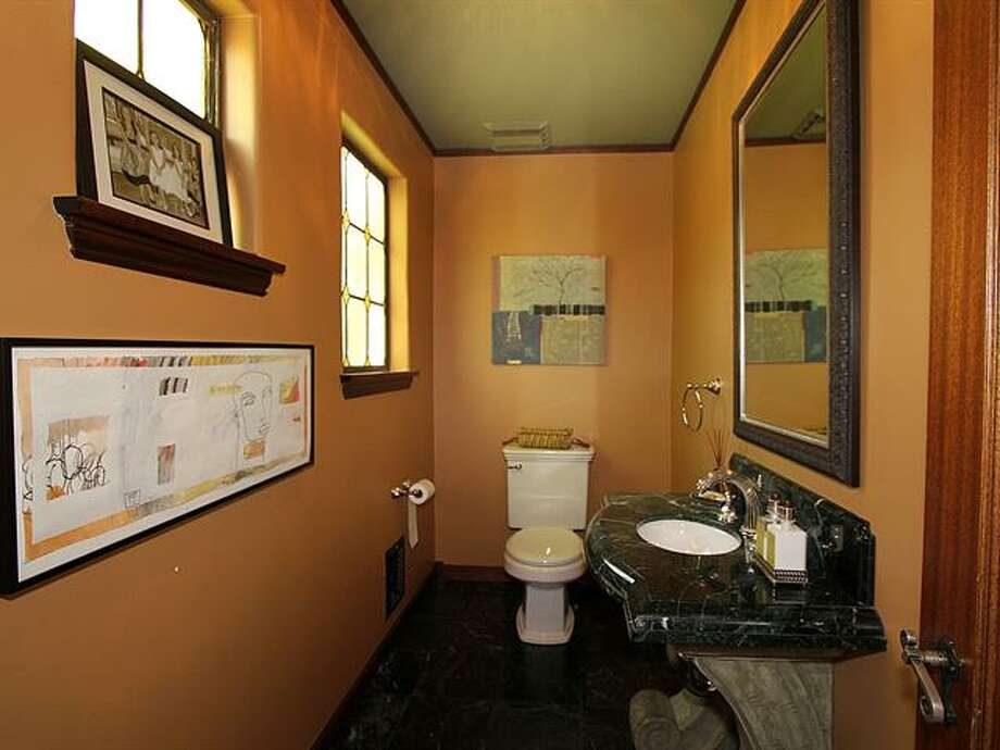 Powder room of 1952 Shenandoah Drive East. The 5,380-squarep-foot house, built in 1928, has five bedrooms, 3.5 bathrooms, a family room with a fireplace, French doors, tile and wood floors, a wine cellar, a terrace and a patio with a fountain on a quarter-acre lot. It's listed for $2.595 million. Photo: Courtesy Adrienne Loop, Windermere Real Estate