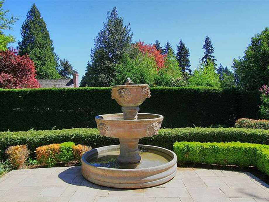 Fountain of 1952 Shenandoah Drive East. The 5,380-squarep-foot house, built in 1928, has five bedrooms, 3.5 bathrooms, a family room with a fireplace, French doors, tile and wood floors, a wine cellar and a terrace on a quarter-acre lot. It's listed for $2.595 million. Photo: Courtesy Adrienne Loop, Windermere Real Estate