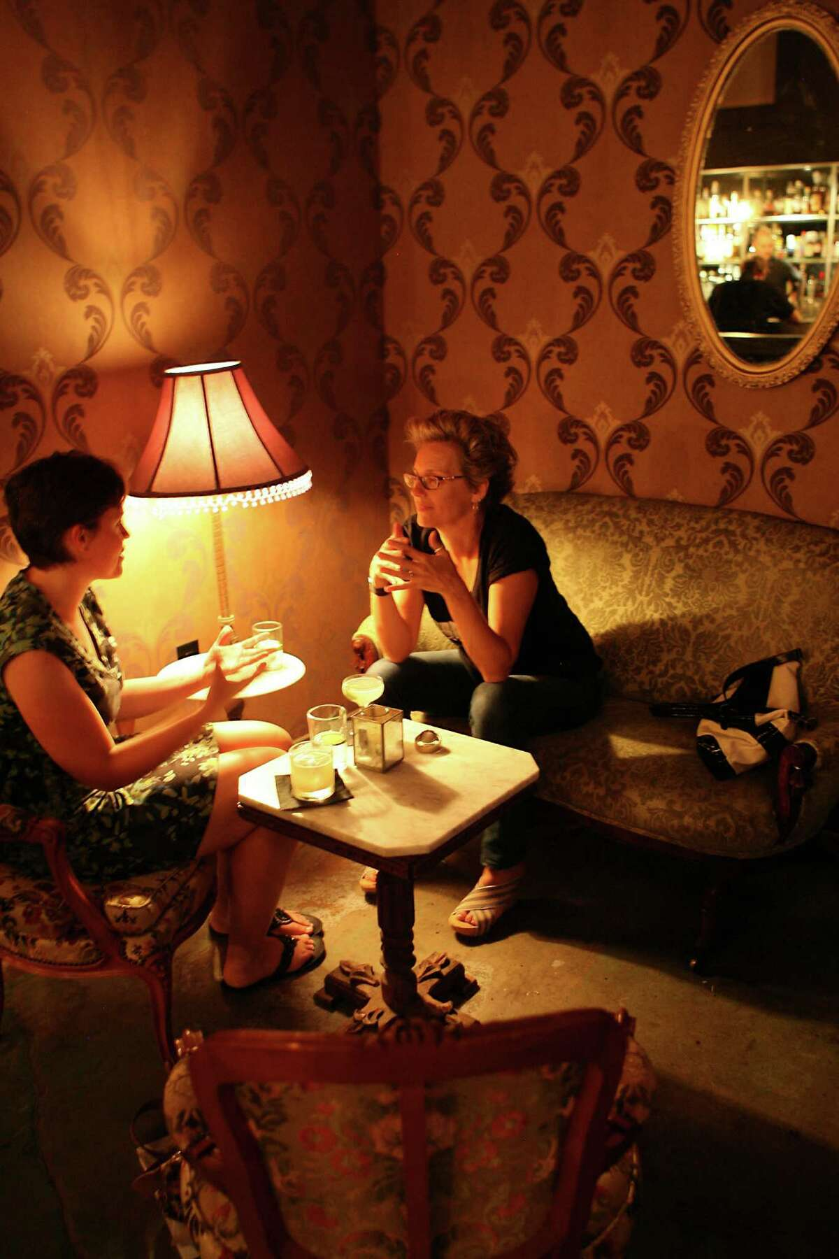 Chrissy Breit (left) and Christine Drennon talk inside The Brooklynite. The Brooklynite is located at 516 Brooklyn Ave.