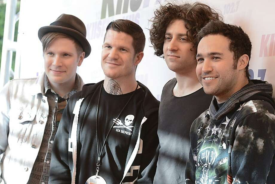 From left to right, singer Patrick Stump, drummer Andy Hurley, musician Joe Trohman, and musician Pete Wentz of the rock band Fall Out Boy arrive at Wango Tango 2013 at The Home Depot Center, Saturday, May 11, 2013, in Carson, Calif. (Photo by Dan Steinberg/Invision/AP) Photo: Dan Steinberg, Associated Press