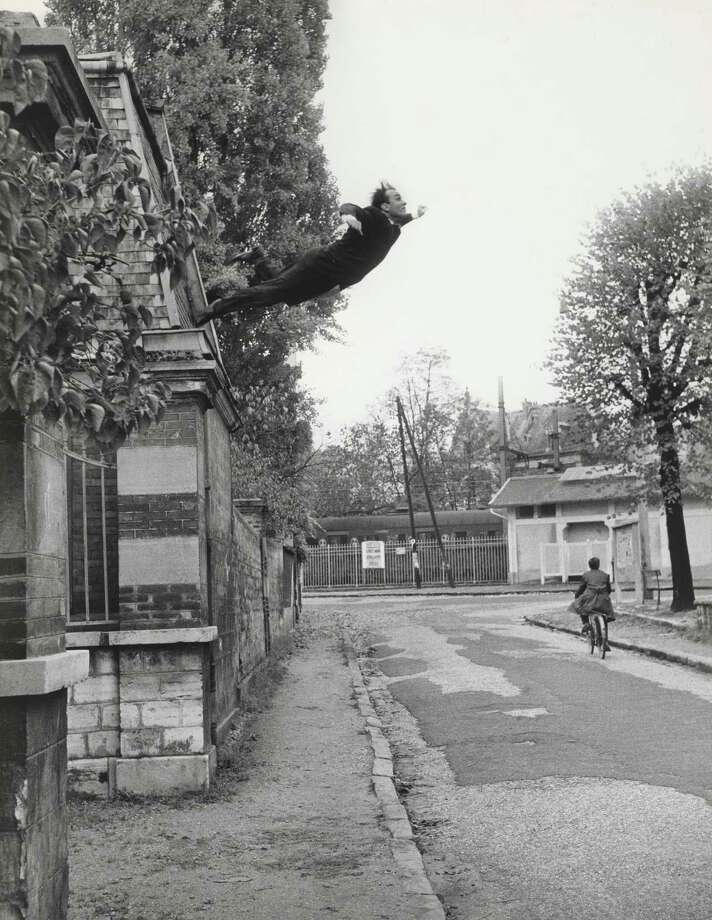"""Yves Klein and Harry Shunk's """"Leap Into the Void"""" (1960, from The Manfred Heiting Collection a MFAH) is among the works on view in """"Faking It: Manipulated Photography Before Photoshop"""" at the Museum of Fine Arts, Houston through Aug. 25. Photo: Skunk-Kender"""