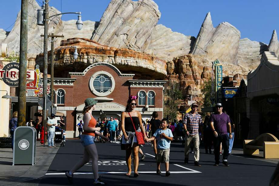 Visitors walk through Cars Land at Walt Disney Co.'s California Adventure Park, part of the Disneyland Resort, in Anaheim, California, U.S., on Friday, May 24, 2013. Walt Disney Co., the world's largest entertainment company, said this month fiscal second-quarter profit rose 32 percent, beating analysts' estimates as guests splurged at theme parks in California and Florida. Photographer: Patrick T. Fallon/Bloomberg Photo: Patrick T. Fallon, Bloomberg