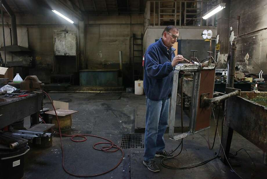 Norbert Bajurin, commodore of Golden Gate Yacht Club, works in the garage at his shop in San Francisco. Photo: Lea Suzuki, The Chronicle