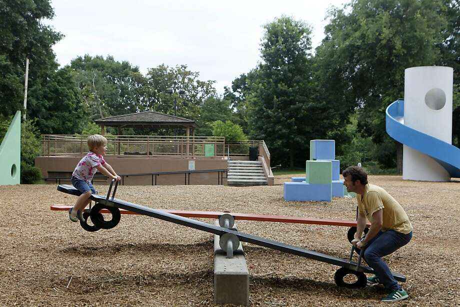 Launch in t-minus 3, 2 ... Kyle Collins, spending some quality time with son Noah, has to check his descent to avoid turning a seesaw into a catapult at Noguchi Playscape in Atlanta. Photo: Jaime Henry-White, Associated Press