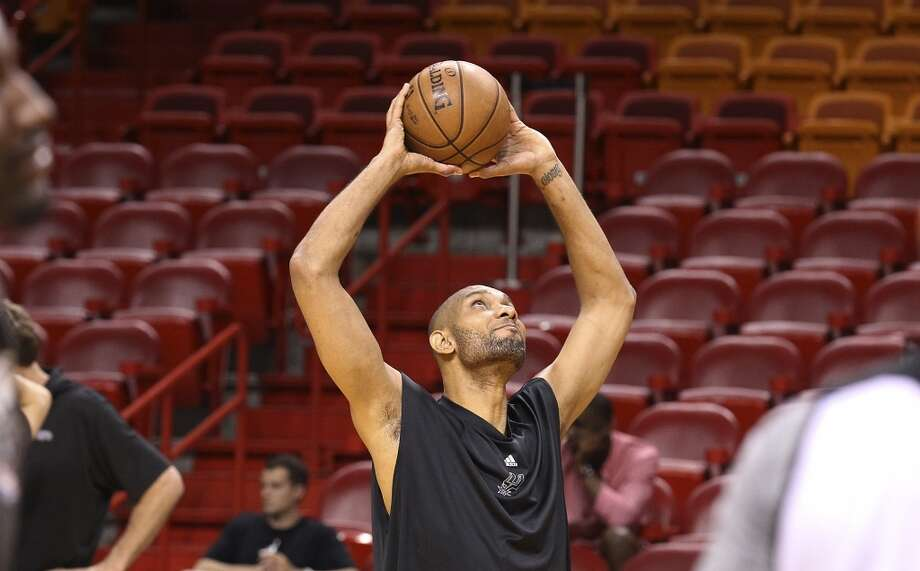 Spurs' Tim Duncan stretches out during practice and media sessions at the American Airlines Arena in Miami on Friday, June 7, 2013. (Kin Man Hui/San Antonio Express-News)