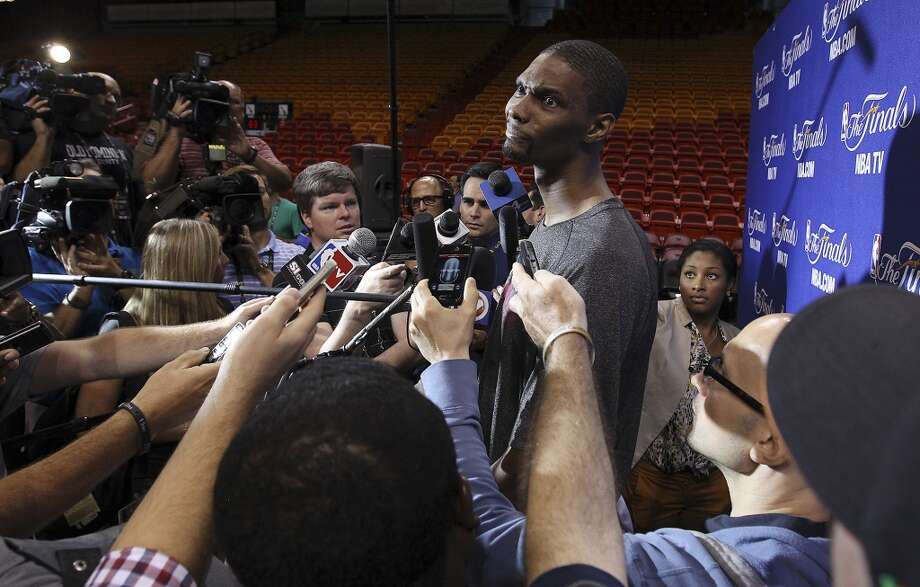 Miami Heat's Chris Bosh appears puzzled while fielding questions during practice and media sessions at the American Airlines Arena in Miami on Friday, June 7, 2013. (Kin Man Hui/San Antonio Express-News)