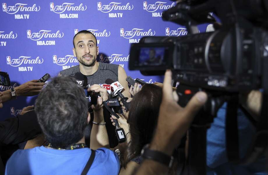 Manu Ginobili answers questions during practice and media sessions at the American Airlines Arena in Miami on Friday, June 7, 2013. (Kin Man Hui/San Antonio Express-News)