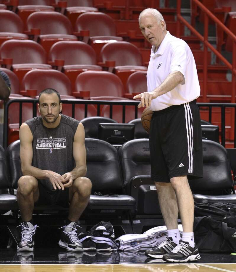 Spurs coach Gregg Popovich (right) chats with Manu Ginobili during practice and media sessions at the American Airlines Arena in Miami on Friday, June 7, 2013. (Kin Man Hui/San Antonio Express-News)