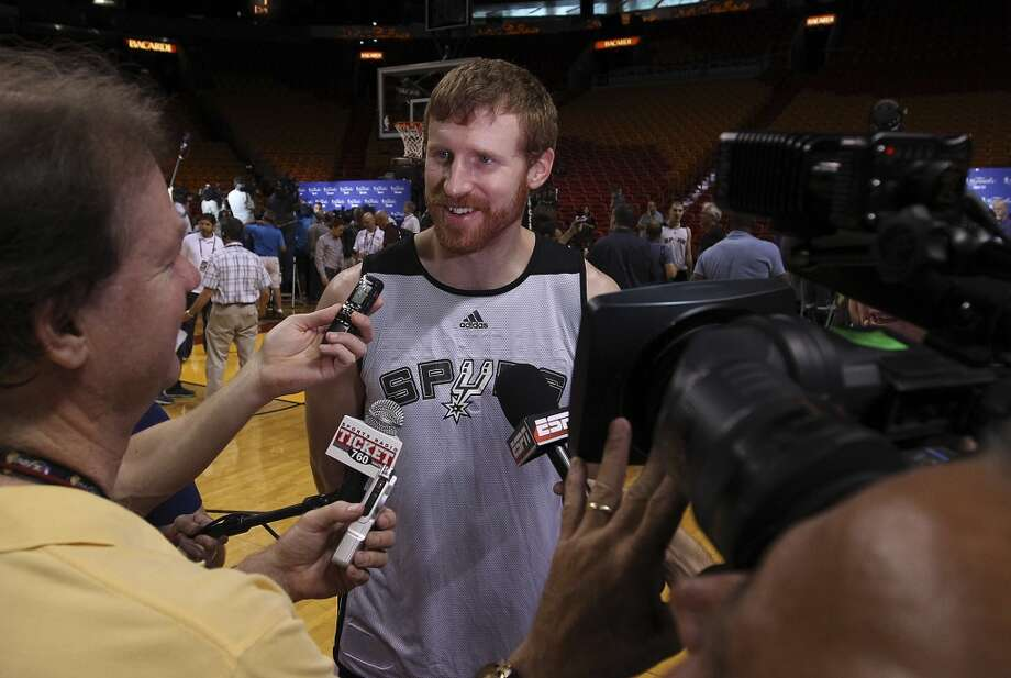 Spurs' Matt Bonner fields questions from reporters during practice and media sessions at the American Airlines Arena in Miami on Friday, June 7, 2013. (Kin Man Hui/San Antonio Express-News)
