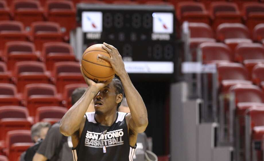Kawhi Leonard takes a jump shot during practice and media sessions at the American Airlines Arena in Miami on Friday, June 7, 2013. (Kin Man Hui/San Antonio Express-News)