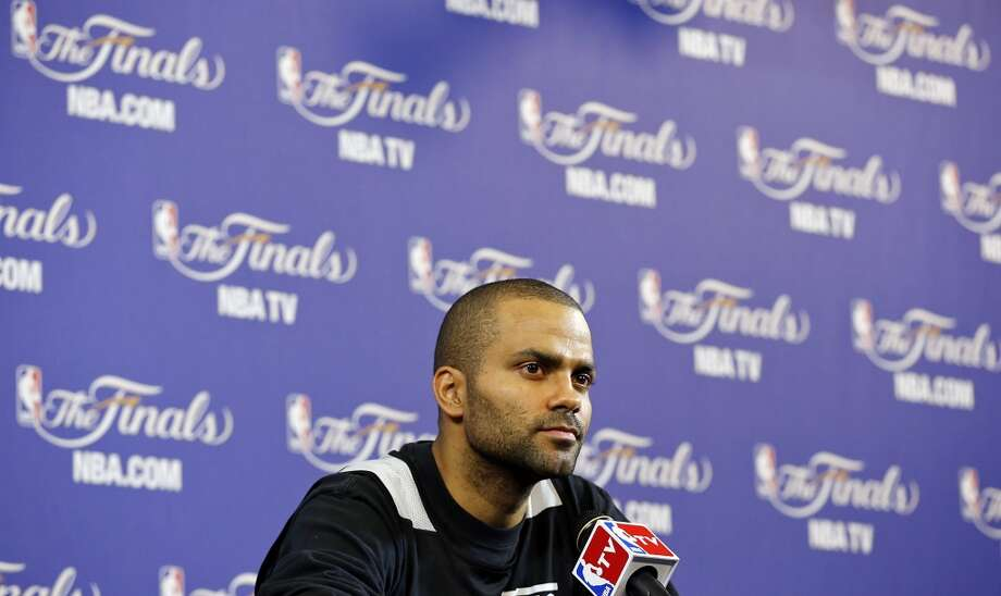 San Antonio Spurs' Tony Parker answers questions from the media during practice Friday June 7, 2013 at American Airlines Arena in Miami, Fla.