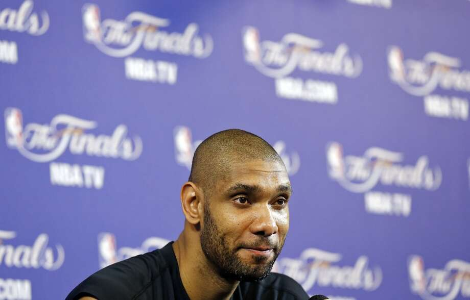 San Antonio Spurs' Tim Duncan answers questions from the media during practice Friday June 7, 2013 at American Airlines Arena in Miami, Fla.