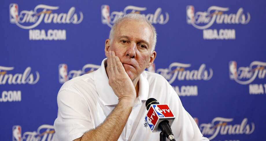 San Antonio Spurs head coach Gregg Popovich answers questions from the media during practice Friday June 7, 2013 at American Airlines Arena in Miami, Fla.