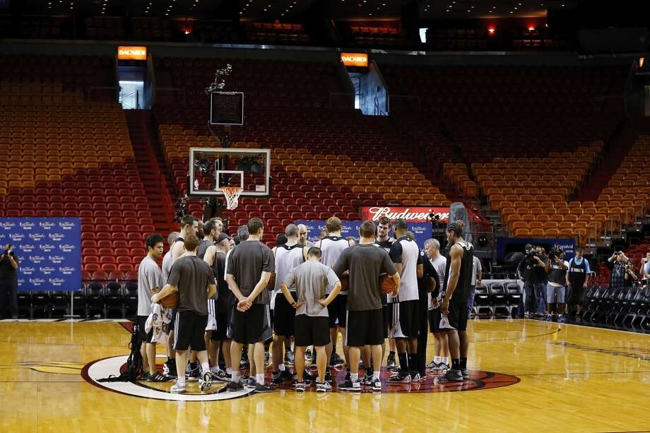 Members of the San Antonio Spurs gather at half court  during practice Friday June 7, 2013 at American Airlines Arena in Miami, Fla.