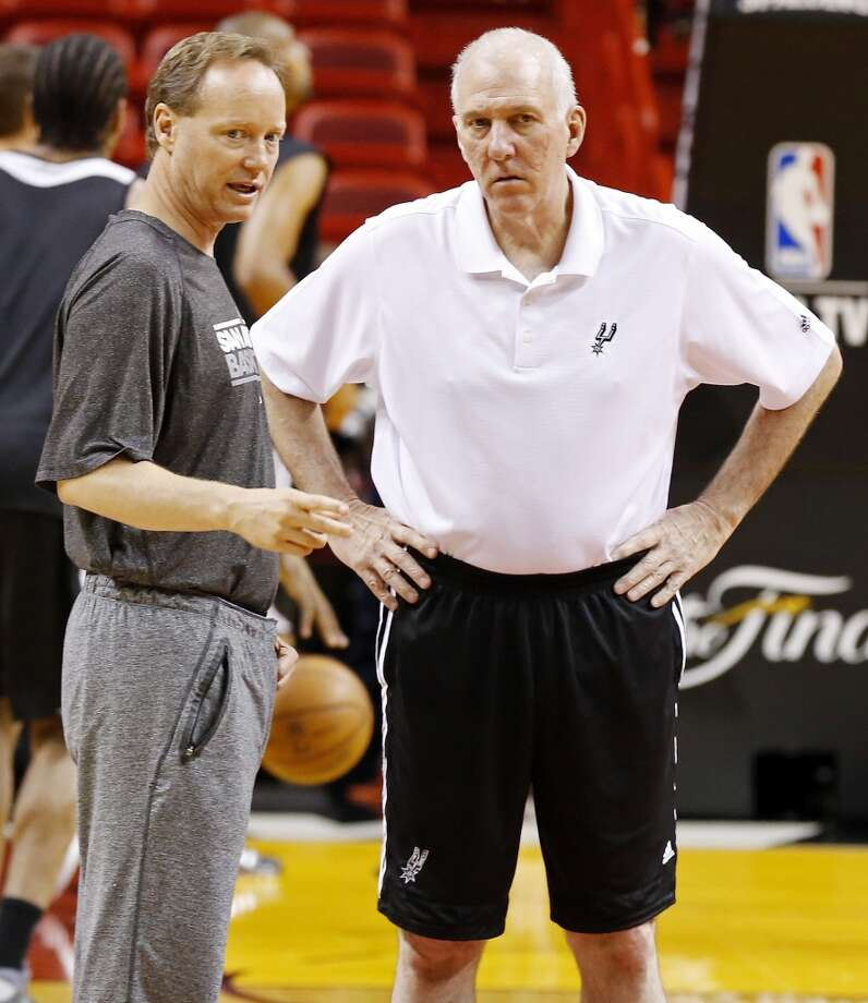 San Antonio Spurs assistant coach Mike Budenholzer (left) and San Antonio Spurs head coach Gregg Popovich talk during practice Friday June 7, 2013 at American Airlines Arena in Miami, Fla.