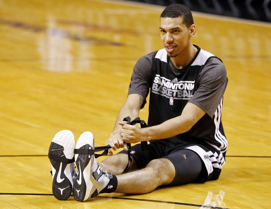 San Antonio Spurs' Danny Green stretches during practice Friday June 7, 2013 at American Airlines Arena in Miami, Fla.
