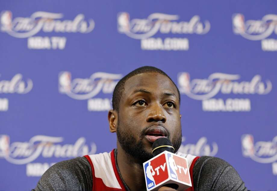 Miami Heat's Dwyane Wade answers questions from the media during practice Friday June 7, 2013 at American Airlines Arena in Miami, Fla.