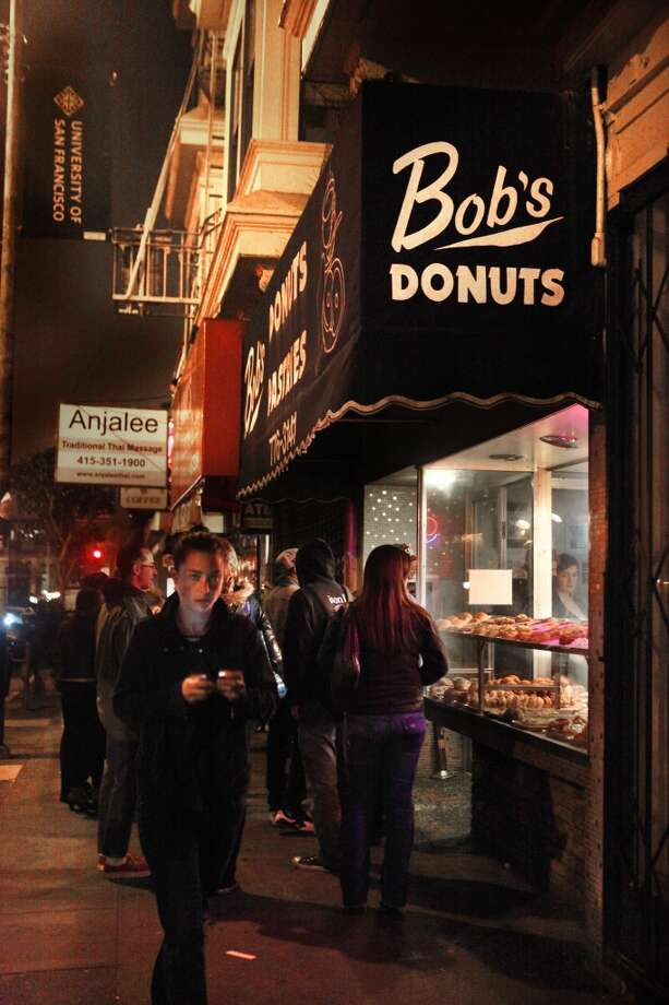 After-hour patrons line up outside of Bob's Donuts, a San Francisco donut institution, at 1621 Polk St. Photo: Liz Hafalia, The Chronicle