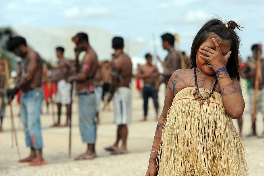 Dam anxiety: Munduruku natives rally outside the Planalto Palace in Brasilia to demand legislation requiring them to be consulted before construction of a $13 billion dam that would displace 16,000 people along the Xingu River. Indigenous groups say the dam would harm their way of life. Environmentalists warn of deforestation, greenhouse gas emissions and irreparable damage to the ecosystem. Photo: Evaristo Sa, AFP/Getty Images