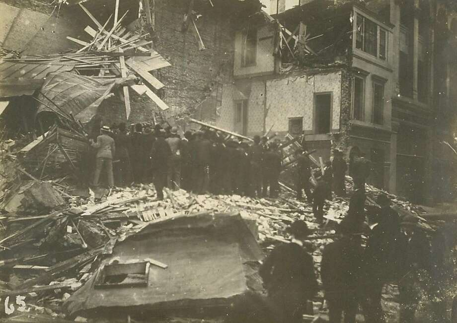 After the 1906 earthquake, people gather to dig bodies out of the ruins at Sixth and Howard streets, where the loss of life was greatest in the city. Photo: -, The Bancroft Library