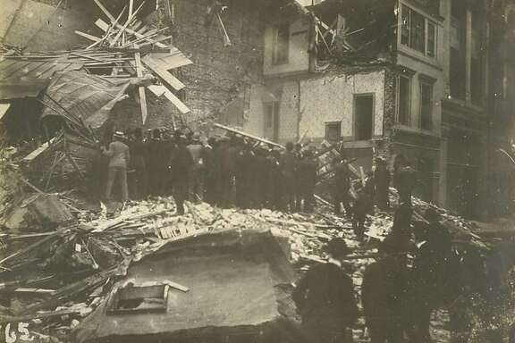 Digging bodies out of the ruins, Sixth and Howard Sts., San Francisco, California after the 1906 earthquake.